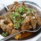 Рецепт тушеной свинины с луком